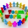 People stand around a word teamwork. Conception of cooperation is in a command — Stock Photo