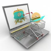 Shopping cart and laptop — Stock Photo