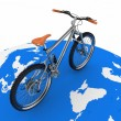Bicycle rolling on the globe. Conception of tourism on an ecological transport. — Stock Photo #29197487