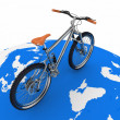 Bicycle rolling on the globe. Conception of tourism on an ecological transport. — Stock Photo