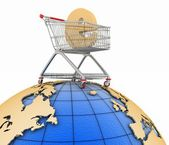 Sign of e-commerce in a trolley on globe — Stock Photo