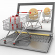 Shopping carts and laptop — Stock Photo #30113029