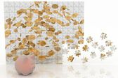 Piggy bank looking at the picture of the puzzle with falling coins — Stock Photo
