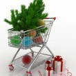 Shopping cart full with christmas balls with fir-tree and gift boxes — Stock Photo