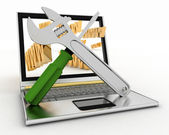 Laptop with screwdriver and wrench — Stockfoto
