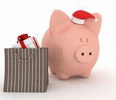 Piggy bank met kerstman hoed en cadeau — Stockfoto