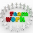 People stand around a word teamwork. Conception of cooperation is in a command. — Stock Photo