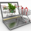 Concept of Christmas online shopping. Laptop computer with festive shopping carts — Stockfoto