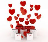 Hearts falling into gift bags — Stockfoto