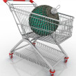 Shopping cart with big christmas ball — Stock Photo