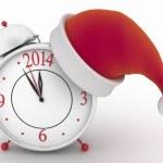Alarm clock with christmas santa hat, — Stock Photo