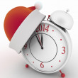 Stock Photo: Alarm clock with christmas santa hat,