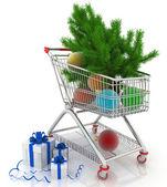Nákupní košík plný s vánoční koule s jedle a dárkové boxy — Stock fotografie