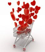 Hearts flying in supermarket trolley. — Stock Photo