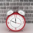 Red alarm clock. 3d icon on brick wall background — Stock Photo #38413299