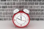 Red alarm clock. 3d icon on brick wall background — Stock Photo