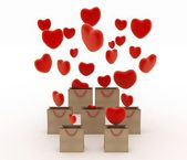Hearts falling into gift bags — Stock Photo