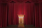 Podium and microphone in the center of the theatrical stage — Stok fotoğraf
