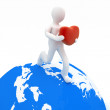 3d man holding heart in his hands and running on the globe — Stock Photo #39209593