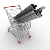 Metal profiles in your shopping cart. Conception of trading. — Stock Photo