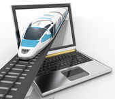 Train coming out of a laptop — Stock Photo