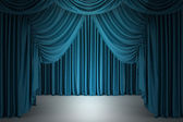 Blue closed the curtain, lit by a spotlight — Stock Photo