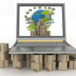 Cardboard boxes around the globe on a laptop screen — Stock Photo
