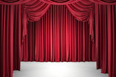 Red closed the curtain, lit by a spotlight — Stock Photo