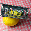 Grating fresh whole lemon — Stock Photo