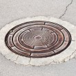 Sewer in a street — Stock Photo
