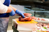 Fishmonger in a market — Stock Photo
