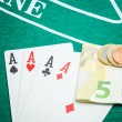 Four aces and euros — Stock Photo