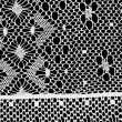 White handmade lace on black background — Stock Photo