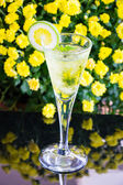Yellow cocktail with a slice of lime — Stock Photo
