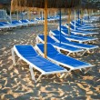 Stock Photo: Sun loungers on beach in Torremolinos, Malaga, Spain