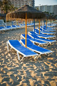 Sun loungers on a beach in Torremolinos, Malaga, Spain — Stock Photo