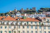 Figueira Square (or Praca da Figueira) in Lisbon, Portugal. View of castle. — Stock Photo