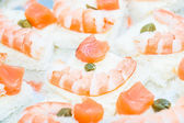 Shrimp and salmon canape — Stock Photo