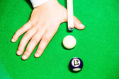 Kid playing pool — Stock Photo