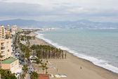 TORREMOLINOS - JANUARY 12: Torremolinos beachfront on January 12, 2012 in Torremolinos, Spain. The Costa del Sol is a popular tourist region that welcomes millions of people annually.   — Stock Photo