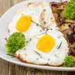 Fried Egg on a heap of roasted Potatoes — Stock Photo
