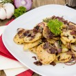 Fried Potatoes with blurred ingredients — Stock Photo