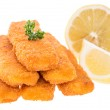 Fish Fingers with lemon pieces on white — Stock Photo #12190460
