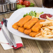 Portion of Fish Fingers on wooden background — Stock Photo