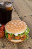 Fish Burger with ingredients on wood — Stock Photo