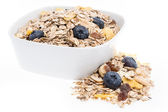 Mixed Muesli in a bowl isolated on white — Stock Photo