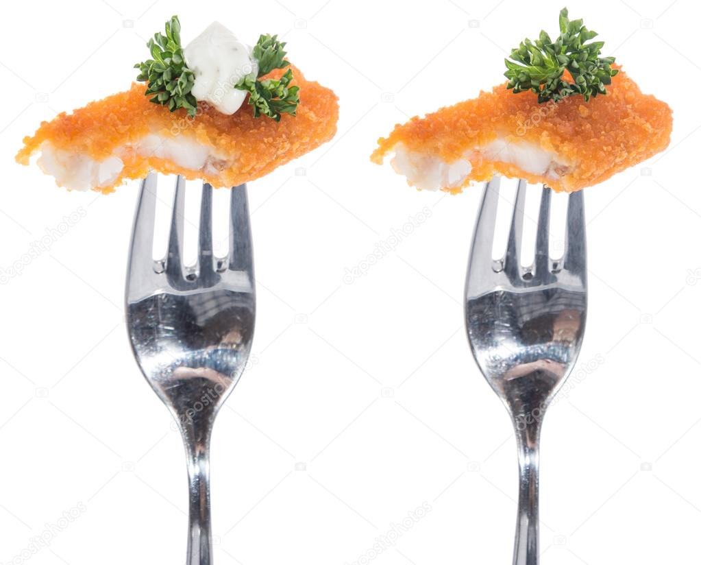 Pieces of fried Fish on a fork isolated on white — Stock Photo #12190447
