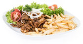 Isolated plate with Kebab and Chips — Stock Photo