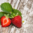 Heap of Strawberries on wood — Stock Photo #12613999