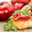Bruschetta on wooden background - Stock Photo